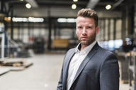 Portrait of confident businessman on factory shop floor - DIGF03555