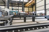 Two men standing on factory shop floor - DIGF03621