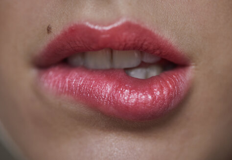 Close-up of woman biting on her lip - PNEF00557