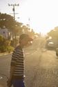 Boy standing on suburban road in Pacific Grove - FOLF05794