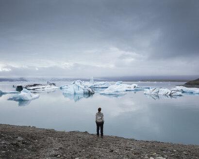 Hiker on shore of Jokulsarlon lake in Iceland - FOLF05872