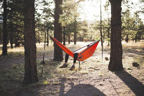 Woman relaxing on hammock in forest - CAVF31722