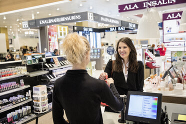 Woman doing shopping in perfumery - FOLF05978