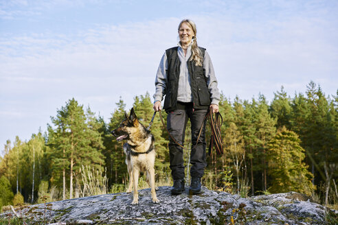 Portrait of volunteer with dog helping emergency services find missing people - FOLF06110