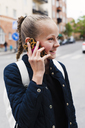 Girl smiling while talking on phone - FOLF06125