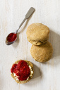 Scones made of einkorn wheat with strawberry jam and clotted cream - EVGF03332