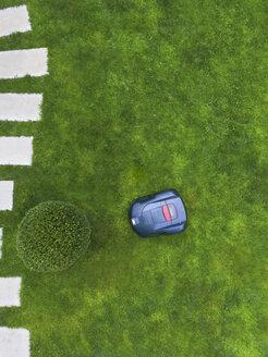 Germany, Bavaria, robotic lawn mower on meadow - MMAF00327
