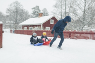 Man pulling children on sled - FOLF06369