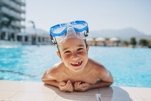 A happy young boy leaning on the edge of a pool - FOLF06561