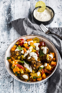 Vegetarian bowl with sweet potato, tomato and falafel, yogurt dip and parsley - SARF03642