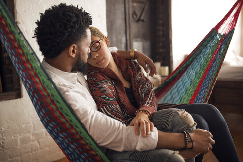 Loving couple relaxing on hammock at home - CAVF32732