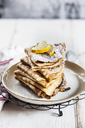 Crepes with icing sugar and lemon - SBDF03494