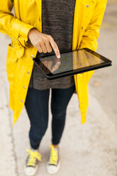 Close-up of woman using tablet with digital street map - VABF01529