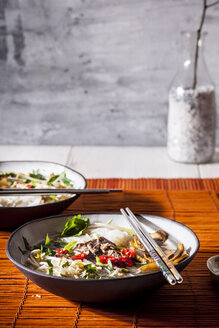 Vietnamese rice noodle soup with mushrooms and beef - SBDF03523