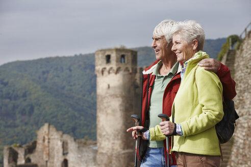 Germany, Rheingau, happy senior couple looking at view - RORF01243
