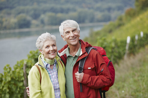 Germany, Rheingau, happy senior couple hiking - RORF01252