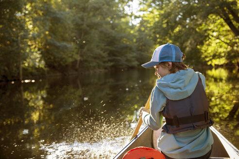 Boy kayaking on river - FOLF07753