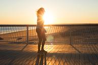 Woman roller skating at sunset - CAVF33517