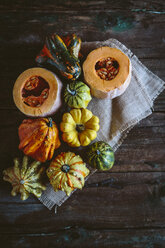Various Ornamental pumpkins on cloth and wood - GIOF03884