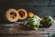 Ornamental pumpkins on wood - GIOF03890