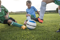 Young football players tackling on football ground - WESTF24042