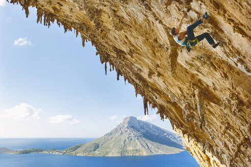 Rock climber on steep cliff at Kalymnos, Greece - FOLF08855
