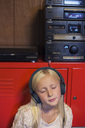 Young girl listening to music on headphones - FOLF08957