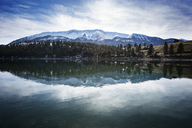 Idyllic view of Wallowa Mountains by lake during winter - CAVF34420