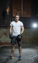 Full length portrait of confident male boxer in gym - CAVF34441