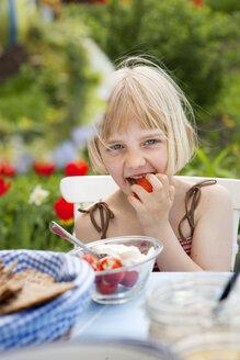 Girleating strawberries with cream - FOLF09448