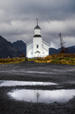 Norway, Lofoten Islands, Gimsoysand, church under cloudy sky - WVF00926