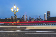 UK, London, traffic light trails on Westminster Bridge at dusk - WPEF00152