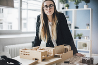 Portrait of architect with architectural model in office - GUSF00595