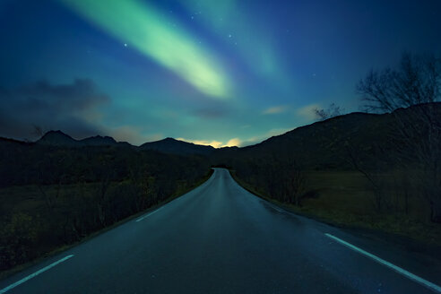 Norway, Lofoten Islands, northern lights above empty road - WVF00963