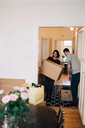 Man and woman with boxes standing in new house - MASF00201