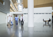 Doctors talking in hospital corridor - CAVF34526
