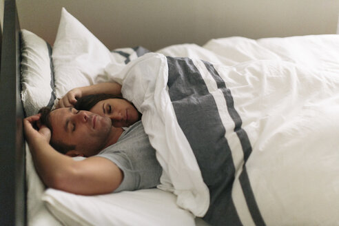 High angle view of couple sleeping in bed at home - CAVF34631