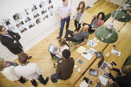 High angle view of business people discussing in meeting at board room - CAVF34811