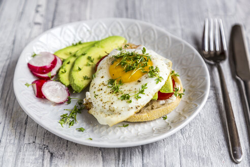 Toast with with fried egg, avocado, red radish, tomato and cress - SARF03657