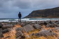 Norway, Lofoten Islands, Eggum, back view of man looking at view - WVF00964