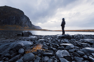 Norway, Lofoten Islands, Eggum, man enjoying nature - WVF00973