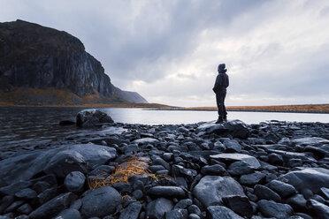 Norway, Lofoten Islands, Eggum, man enjoying nature - WVF00973