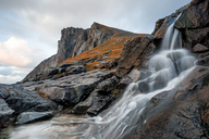 Norway, Lofoten Islands, Waterfall near Kvalvika Beach - WVF01021