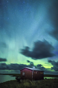 Norway, Lofoten Islands, Eggum, northern lights and wooden hut - WVF01034