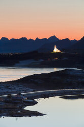 Norway, Lofoten Islands, Leknes, view to illuminated church - WVF01079