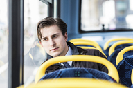 UK, London, portrait of serious businessman sitting in bus - WPEF00176