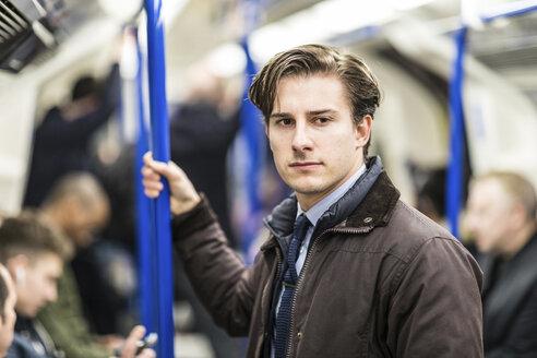 UK, London, portrait of businessman in underground train - WPEF00179
