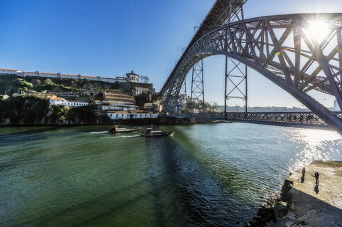 Portugal, Porto, Old town, Douro river and Luiz I Bridge against the sun - THAF02149