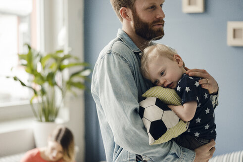 Father spending time with his son at home - KNSF03704