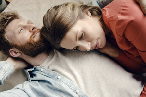 Affectionate couple cuddling at home - KNSF03722